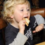 blond boy eats pizza#28BBDF